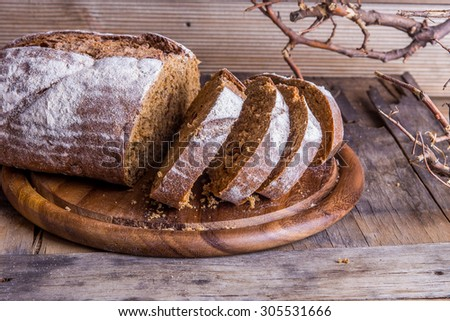 Rustic bread on an old vintage planked wood table