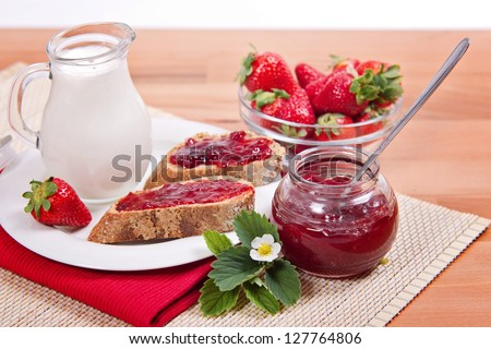 Rustic Bread with fresh Strawberry Jam and fruits