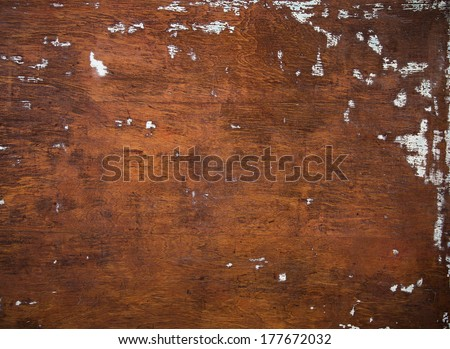 Rustic Brown Wood Background with Wood Grain and Light Blue Paint Spots - stock photo
