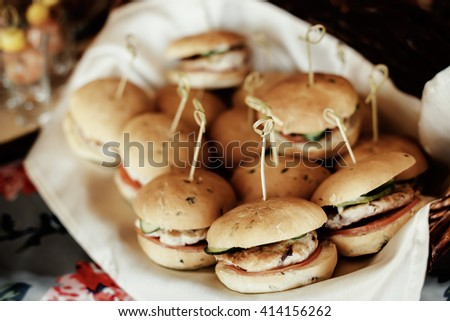 rustic catering service buffet table with delicious burgers - stock photo