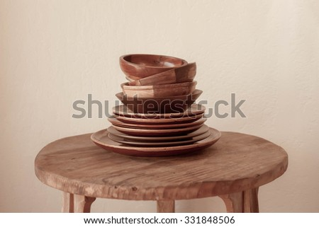 Rustic Ceramic bowls and plates on wood background. side view