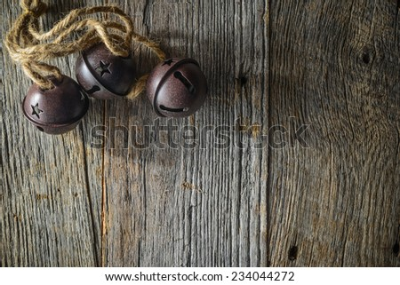 Rustic Christmas Bells and Wood Background - stock photo