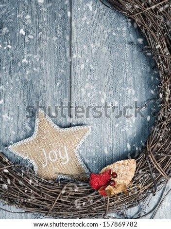 Rustic Christmas wreath in winter snow - stock photo