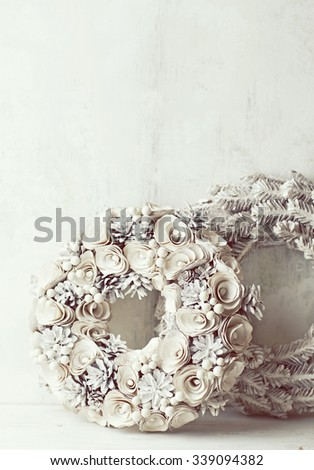Rustic Christmas wreaths on a white wooden background - stock photo