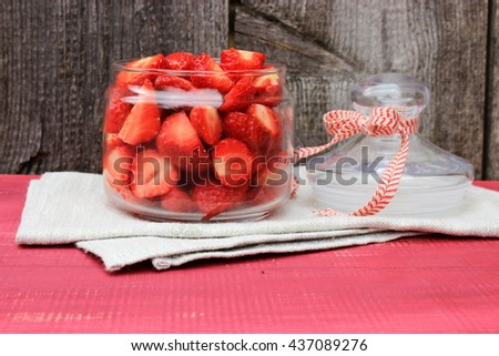 Rustic composition with bowl full of sweet tasty ripe strawberry, fresh natural dessert. Vintage kitchen decor. Romantic style. Red and grey color - stock photo