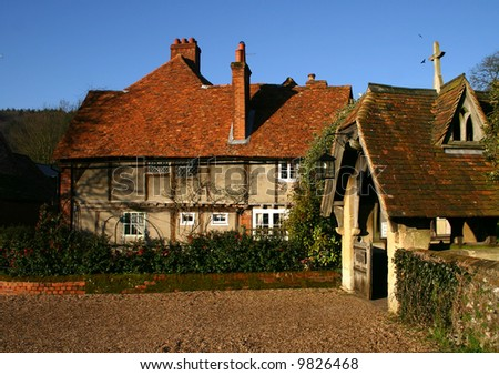 Rustic cottage and Church Entrance Porch in the Buckinghamshire village of Hambleden UK - stock photo