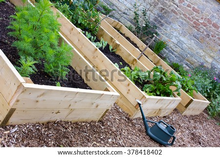 Rustic Country Vegetable & Flower Garden with Raised Beds. - stock photo