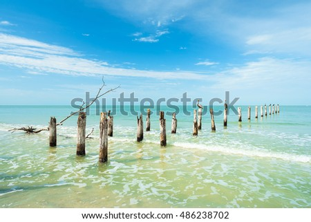 Rustic decaying pier along Fort Myers Beach on the west coast of Florida.