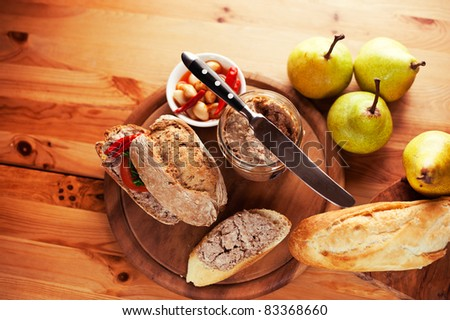 Rustic dinner with bread rolls, pate and pears