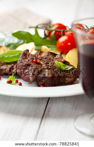 Rustic dinner with grilled beef and vegetables - stock photo