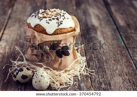 Rustic Easter cakes  with nuts and chocolate sprinkles on wooden  background, toned - stock photo