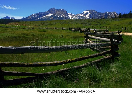 Rustic fence at the foot of the Sawtooth Range, Stanley Idaho - stock photo