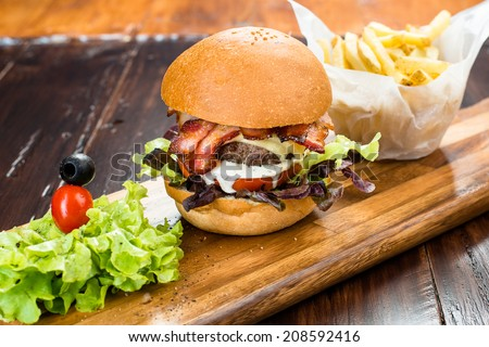 Rustic Home Hamburger with Salad and French Fries - stock photo