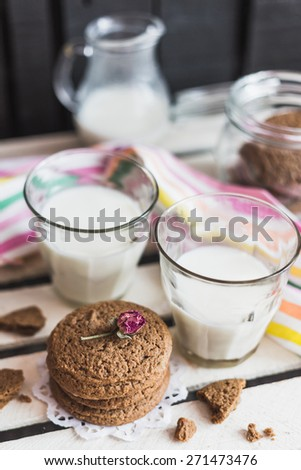 Rustic home made tasty  cookies on the wooden background with milk. Selective focus photo with shallow DOF. - stock photo