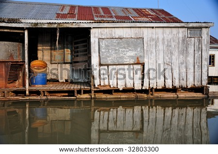 Rustic house on water