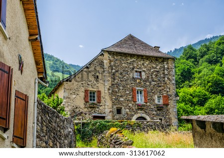 Rustic houses in the French village of Borce. - stock photo