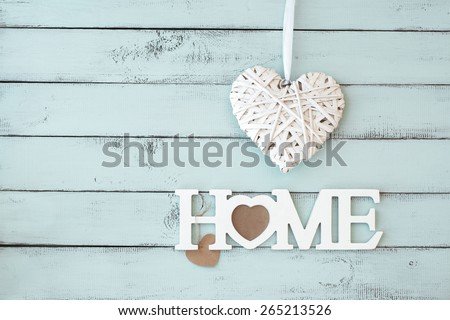 Rustic interior decor Home on a mint shabby chic wall - stock photo