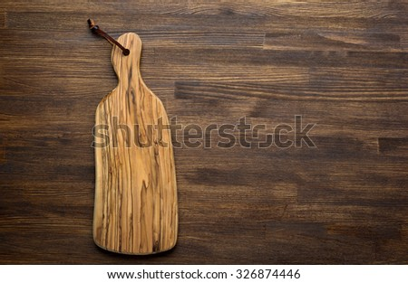 Rustic kitchen board on wooden table - stock photo