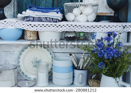 Rustic kitchen interior with shelves and flower. - stock photo