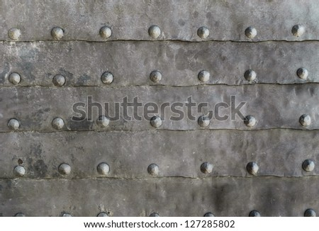 Rustic metal texture with old nails - stock photo