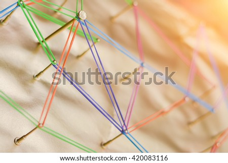 Rustic nails in wood linked together by cotton with a golden tint.Abstract background networking,social media, internet communication,link concept. - stock photo
