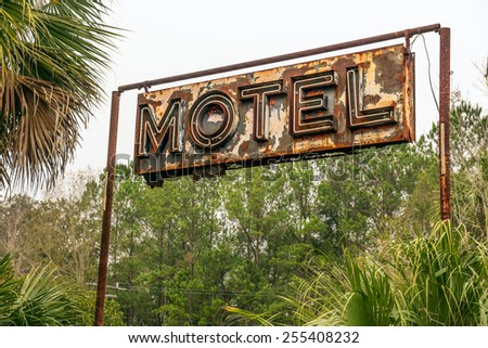 Rustic Neon Motel Sign in Florida, United States - stock photo