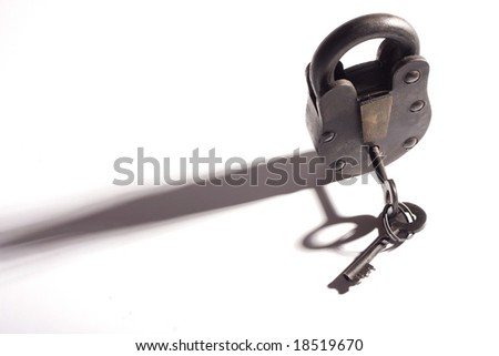 rustic old padlock on a white background - stock photo