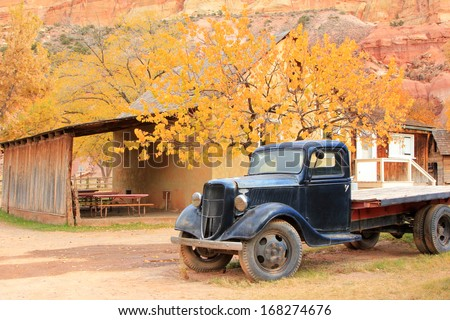 Rustic old truck with autumn leaves in southern Utah, USA. - stock photo