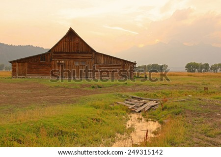 Rustic old wooden barn, Wyoming, USA. - stock photo