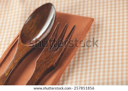 Rustic orange country wooden table setting (Shallow DOF) - stock photo
