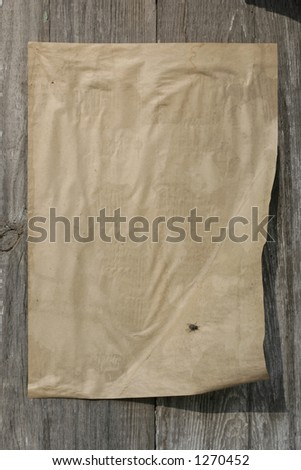 rustic paper on a wall - stock photo