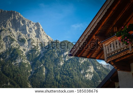 Rustic Photograph Of A Traditional Alpine Chalet In The Summer - stock photo