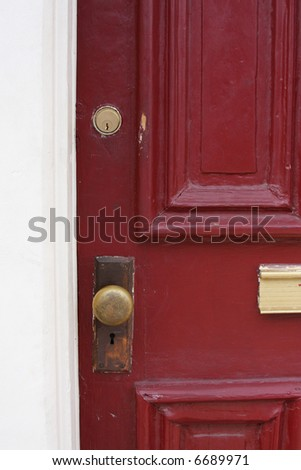 Rustic red door. - stock photo