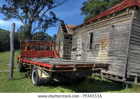 rustic red truck against blue sky - stock photo