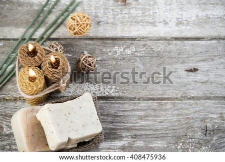 Rustic setting with natural olive soap and honey candles, SPA background from above with copy space - stock photo