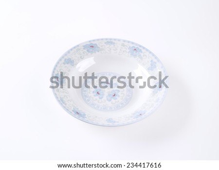 rustic soup plate on white background