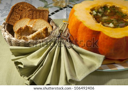 rustic soup with mixed vegetables and pumpkin - stock photo