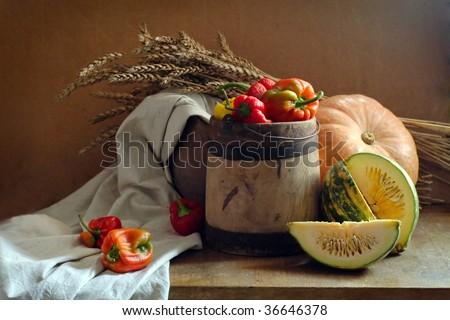 rustic still life of vegetables and wheat sunlit - stock photo