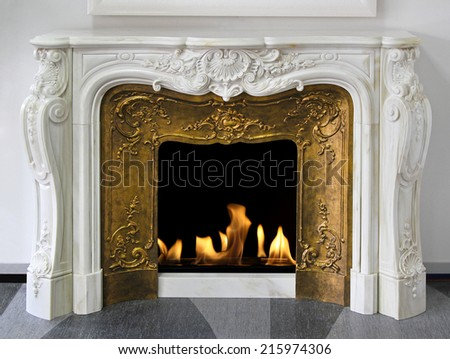 Rustic style fireplace in white marble with gold - stock photo