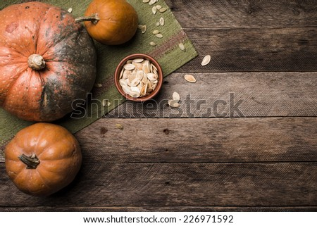 Rustic style pumpkins with seeds on wooden table. Autumn Season food photo - stock photo