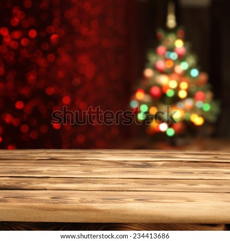 rustic table and xmas tree  - stock photo