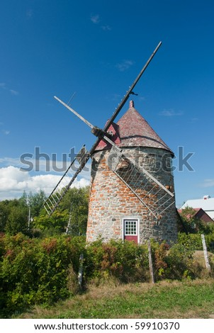 rustic 19th century windmill on ile-aux-coudres in the st. lawrence