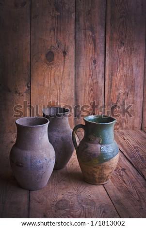 Rustic utensils. Pitchers. - stock photo
