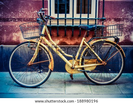 Rustic VIntage Old Bicycle On A Backstreet In Italy - stock photo