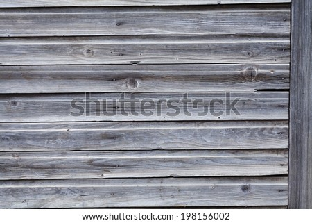 rustic weathered barn wood background with knots and nail holes - stock photo