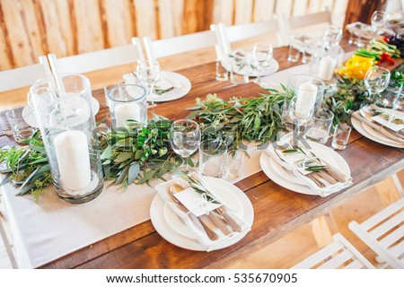 Rustic wedding decor wedding table setting with candles and eucalyptus. & Rustic Wedding Decor Wedding Table Setting Stock Photo (Safe to Use ...