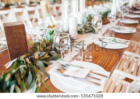 Rustic wedding decor wedding table setting with candles and eucalyptus. & Rustic Wedding Decor Wedding Table Setting Stock Photo u0026 Image ...