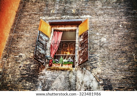 rustic window in a brick wall in Bologna, Italy - stock photo