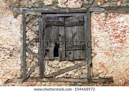 Rustic Window Shutter of Abandoned Building - stock photo