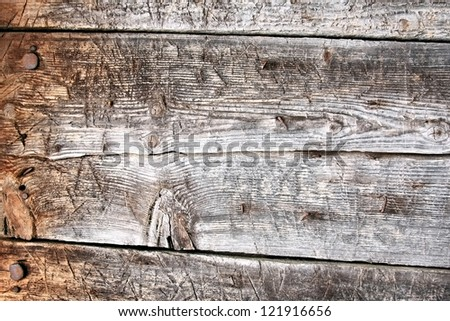 Rustic wood background / old textured wood planks with bolts on one edge - stock photo